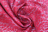 Swirled swatch red fabric (bright red marbled look fabric with silver metallic tree branch/scratch look pattern allover)