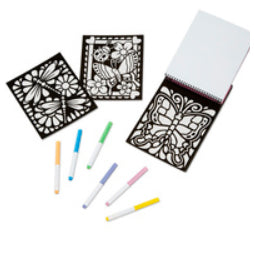 A set of three velvet colouring sheets with an array of white markers with coloured lids below them.  One features two dragonflies on flowers and the other two sheets feature butterflies, one with flowers and a ladybug, the other in a stained-glass style.