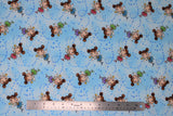 Flat swatch magical themed printed fabric in print fairies (light blue marbled fabric with tiny blue stars and cartoon brunette fairies with two side buns and gold star wands, pink/blue/green/purple dresses)