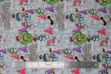 Flat swatch magical themed printed fabric in print castles (light blue/grey fabric with tiled castles with some pink and purple bricks, cartoon fairies, unicorns, dragons and knights in various colours)