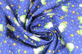 Swirled swatch magical themed printed fabric in print frog prince (dark blue fabric with tiny light blue stars tossed and cartoon green frogs with gold crowns and gold stars)