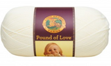 A ball of Lion Brand Pound of Love yarn on white background in shade antique white (off white)