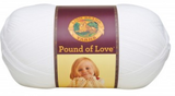 A ball of Lion Brand Pound of Love yarn on white background in shade white