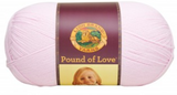 A ball of Lion Brand Pound of Love yarn on white background in shade pastel pink