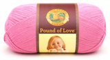 A ball of Lion Brand Pound of Love yarn on white background in shade bubblegum (bright pink)