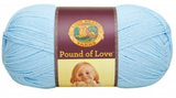 A ball of Lion Brand Pound of Love yarn on white background in shade pastel blue