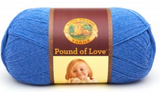 A ball of Lion Brand Pound of Love yarn on white background in shade denim (bright medium blue)