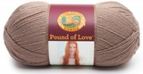A ball of Lion Brand Pound of Love yarn on white background in shade taupe