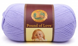 A ball of Lion Brand Pound of Love yarn on white background in shade lavender
