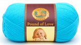 A ball of Lion Brand Pound of Love yarn on white background in shade turquoise (bright)