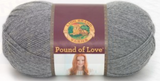 A ball of Lion Brand Pound of Love yarn on white background in shade oxford grey