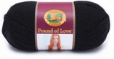 A ball of Lion Brand Pound of Love yarn on white background in shade black