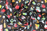 Swirled swatch camping toss fabric (black fabric with tiny full colour camping emblems tossed allover: campers, kayaks, BBQs, guitars, fire, chair, flashlight, etc.)
