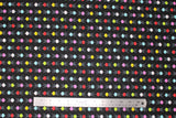 Flat swatch BBQ fabric (black fabric with tiled tiny circular 3-leg BBQs in yellow, white, pink, red, blue)