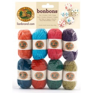 Package of 8 mini yarn balls in collection Celebrate (metallic twisted strands; colours: orange, peacock blue, hot pink, purple, teal, red, forest green, olive green)
