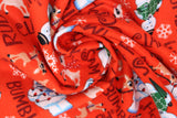 Swirled swatch Rudolf the Red Nosed Reindeer licensed print fabric on red