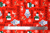 Flat swatch Rudolf the Red Nosed Reindeer licensed print fabric on red