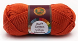 A single ball of Lion Brand 24/7 Cotton in Tangerine