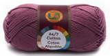 A single ball of Lion Brand 24/7 Cotton in Lilac
