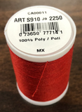 A spool of Coats & Clark Dual Duty All Purpose thread in Red