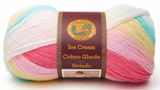 Ball of Lion Brand Ice Cream in colourway Tutti Frutti (bright pink, soft pink, yellow, turquoise, white)