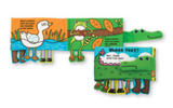 Cover and page display for soft book Whose Feet.  Cover shows crocodile with crocodile face folded over the cover, while an assortment of different animal feet dangle below.  Page display shows duck with dangling feet on the left and frog with dangling feet on the right, with small/illegible text.