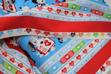 Raw hem swatch happy helpers 2 fabric (thick blue stripes with cartoon dogs and medical equipment, thick red stripe with cartoon cats and mice with medical equipment, separated by white striped with hearts/beat lines, coloured band-aids, etc.)