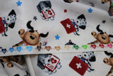Raw hem swatch first aid friends fabric (white fabric with tossed cartoon dogs and cats in white, black, grey, tan colours with first aid kits red with white plus, medical charts, x-rays, etc. and tossed stars in grey, blue, red)