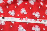 Raw hem swatch miss mousey fabric (red/dark red marbled look fabric with tossed white hearts and grey cartoon mice with pink gingham ears and white nurses hats)