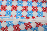 Raw hem swatch bandage fabric (white fabric with alternating stripes of bandage x's made from blue and red bandages)