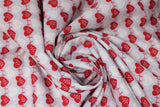 Swirled swatch heartbeat fabric (grey fabric with alternating stripes of red hearts with red/white beat lines, and faint white hearts with beat lines)