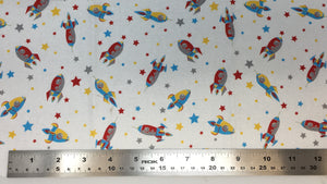 Group swatch cartoon rocketships and stars fabric in various colours
