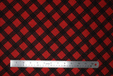 Flat swatch of red and black diamond plaid