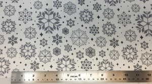 Group swatch snowflake variety printed fabric in various colours