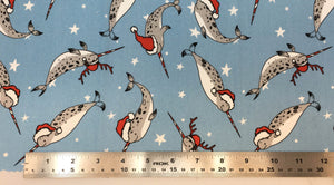 Group swatch santa hat cartoon narwhals printed fabric in various colours