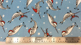 Flat swatch santa hat cartoon narwhals printed fabric in blue