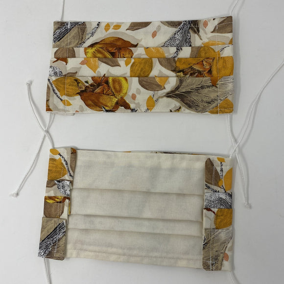 Front and back photo: pick your print face mask (off white mask with brown/yellow/orange assorted realistic leaves pattern and white elastic ear loops)