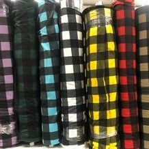 Bolts of buffalo plaid printed polar fleece in a variety of colours