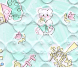Child-drawn style houses and teddybears with green background printed on quatrefoil-quilted vinyl