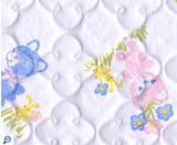 Furry pink and blue teddies and yellow bunnies printed on white quatrefoil-quilted vinyl