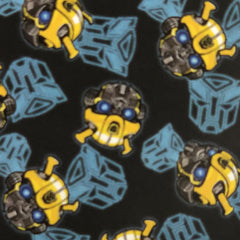 Square swatch Transformers printed fabric (black fabric with yellow bumblebee heads and grey transformers logo tossed)