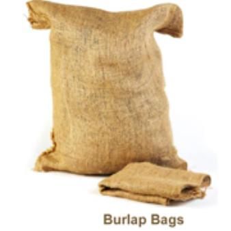A filled burlap bag sits against a white background.  An empty, folded burlap bag lies in front of it, with the words
