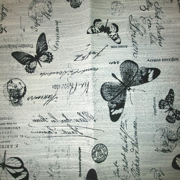 Black and White upholstery fabric featuring images of butterflies and scribbled notes reminiscent of a Victorian biologist's notebook