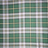 Swatch of Cape Breton tartan, featuring black outlined white bands and yellow fine stripes on a green background