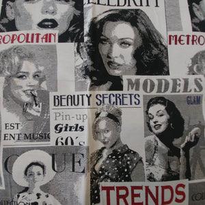 Woven upholstery fabric featuring stacked black and white magazine covers with red and navy accent text and titles such as Models and Beauty Secrets.  Magazine covers feature women resembling classic Hollywood leading ladies