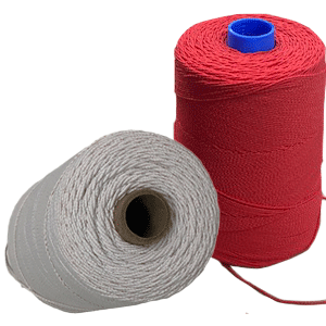 Two large spools of narrow braided elastic, one white, one red