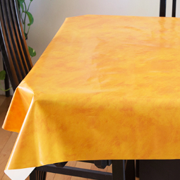 Yellow Suede (lightly textured bright yellow) opaque vinyl draped over a dining room table with matching chairs around it.