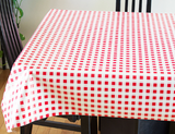 Red & White Check (rows of red squares on a white background, resembling gingham) opaque vinyl draped over a dining room table with matching chairs around it.