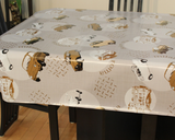 "Cars (taupe and white vintage sedan cars and diamond plate steel patches scattered around off-white circles on a tan background, with occasional words like ""roma"" and taupe line drawings) opaque vinyl draped over a dining room table with matching chairs around it."
