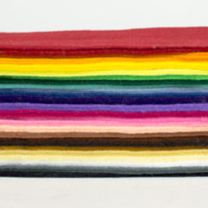 A side-view of a stack of felt in a rainbow of shades